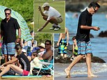 Mitt Romney celebrated New Year's Day with his family on a beach in Maui while Obama played golf just miles away