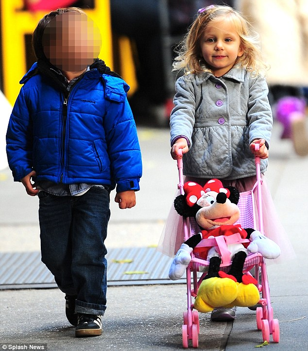 All grown up: She proudly showed it off to her friends as she pushed the pram down the road