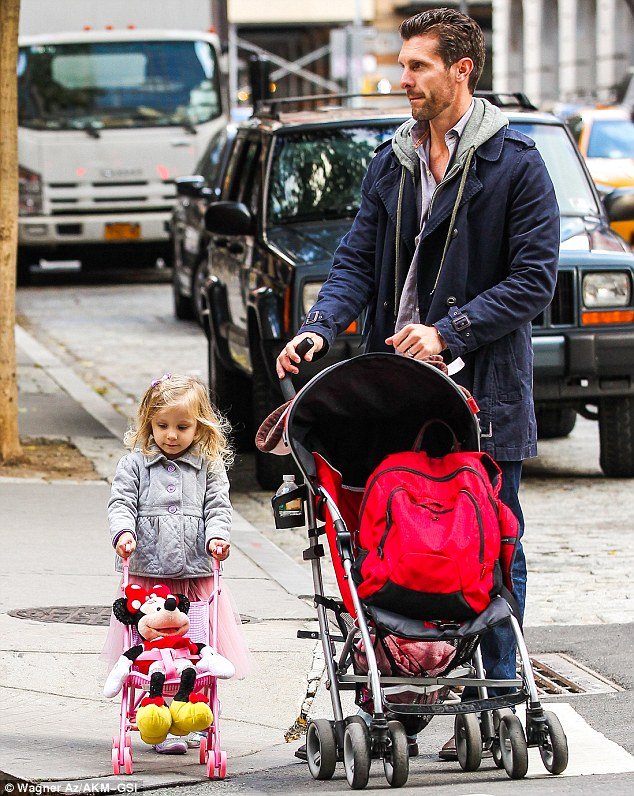 Double drivers: Jason pushed Bryn's big pram while she pushed Minnie in the mini-version