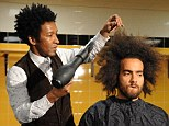 A snip at half the price: Barber Lance Lowe (left) gets ready to cut Tom Huddlestone's hair