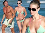 Well, she is a Sports Illustrated Swimsuit model... Julie Henderson bared her toned body in a tiny two-piece in Miami, Florida on Thursday