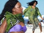It's Pele Rowland! Destiny's Child star covers up her fantastic bikini body to enjoy a frenetic kickaround on the beach