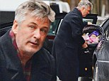 Where's Hilaria when you need her? Alec Baldwin looks puzzled as he struggles to get baby Carmen's carrier in the car