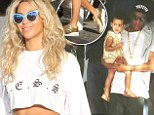 Golden family! Beyonce steps out in glittery gold trainers to match Blue Ivy's top and even Jay-Z gets involved with blinged out medallion