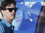 Low key: Kaley Cuoco and her new husband, tennis player Ryan Sweeting were pictured for the first time since their magnificent New Year's Eve wedding, grabbing lunch at In-N-Out in Los Angeles on New Year's Day