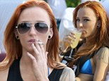 She's 'Off Duty' right now: Teen Mom star Maci Bookout spotted smoking and drinking during bikini romp at Miami Beach despite recent battle with painful illness