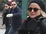 Amy Poehler looks chic in all-black as she enjoys her last bit of holiday recreation with beau Nick Kroll as Golden Globes hosting gig approaches