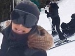 'Uh oh, she's going down!' Kim Kardashian wipes out on the slopes while trying to ski between Kourtney's legs