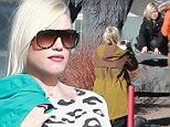 From rock star to... wildlife photographer? Pregnant Gwen Stefani snaps pictures of son Zuma posing with life-size mammoth statue