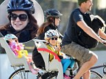 Alyson Hannigan teams helmet with glamorous sunglasses for bike ride with Alexis Denisof and daughters Keeva and Satyana