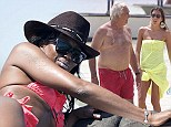 The morning after: Naomi Campbell starts New Year wearing fuchsia bikini for day at sea... while ex Flavio Briatore hits beach with wife Elisabetta and son