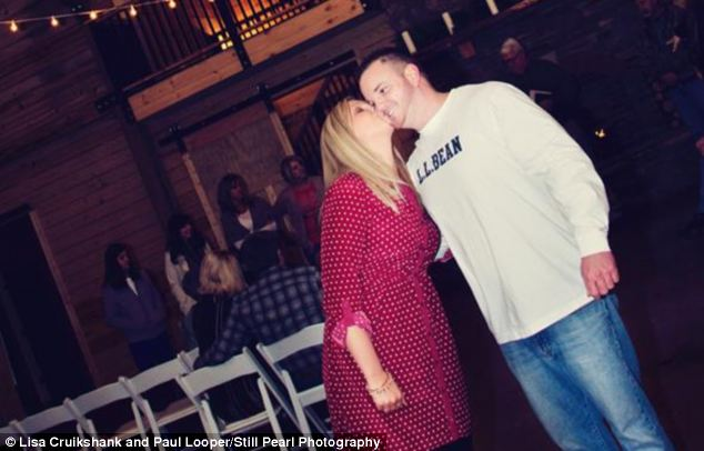 Excitement: The couple is pictured sharing a kiss during the rehearsal the night before their wedding