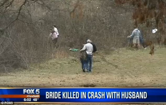 Heartbroken: Family and friends comfort each other at the scene of the crash where Dobson died