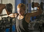 Determined: Jake weight trains at his local gym a few days before a competition last May