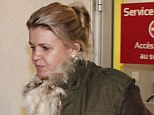 Corinna Schumacher has been by her husband's bedside in hospital since the accident (Corinna pictured leaving hospital today)