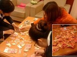 A Chinese toddler's habit of tearing up old books proved costly for his parents when he shredded £3,000