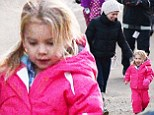 Pink struggles to keep hold of excited daughter Willow as she dashes along during snowy Californian holiday