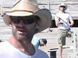 Seaside excursion: Hugh Jackman was seen at a pier alongside the coast outside of Melbourne, getting in some fishing with 13-year-old son Oscar and friends, on Thursday