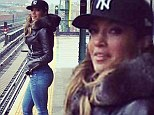 She's still Jenny from the Block: Dressed down Jennifer Lopez shows off her shapely derriere in skintight jeans for casual snap
