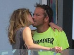 Still got it: Stephen Dorff and model girlfriend Katharina Damn show they are still very much a couple with an impromptu kiss