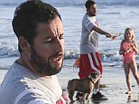 Man and children! Adam Sandler treats his daughters to a day at the beach as he enjoys holiday break