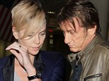 Sean Penn and Charlize Theron attempt incognito arrival into Los Angeles after Hawaiian holiday together