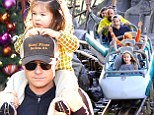Jason Bateman proves he's a big kid at heart as he treats daughters to a trip to Disneyland with wife Amanda