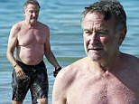 He's fighting off the extra Flubber! Comedian Robin Williams works off his holiday weight gain with a bit of snorkeling in Hawaii