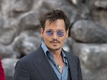 Resolved: Johnny Depp has allegedly settled a lawsuit with a woman who claimed the actor's bodyguards tackled her to the ground at an Iggy Pop concert in 2011, Depp pictured in London in July