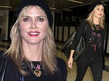 Model coming through: Heidi Klum was seen strutting her stuff through the Los Angeles International Airport on New Year's Day right after a trip to Las Vegas, put together perfectly