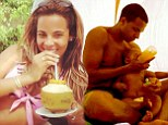 Family time: Rochelle lets Marvin take over parenting duties as she relaxes on the beach during family holiday in the Maldives