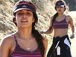 Perks of warm winters! Make-up free Vanessa Hudgens bared her taut tummy on a hike with a gal pal in Los Angeles, California on Thursday