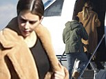 Whizzing back home: The Kardashian clan stand surrounded by luggage before boarding private jet in Utah