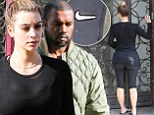 Oops! Kim Kardashian squeezes her famous derrière into NIKE leggings as she heads to Adidas meeting with Kanye West