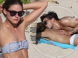 Newly engaged Olivia Palermo sunbathes topless during PDA-filled beach day with fiancé Johannes Huebl