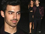 In love again! Joe Jonas holds hands with girlfriend Blanda Eggenschwiler after ONE MONTH of no PDAs
