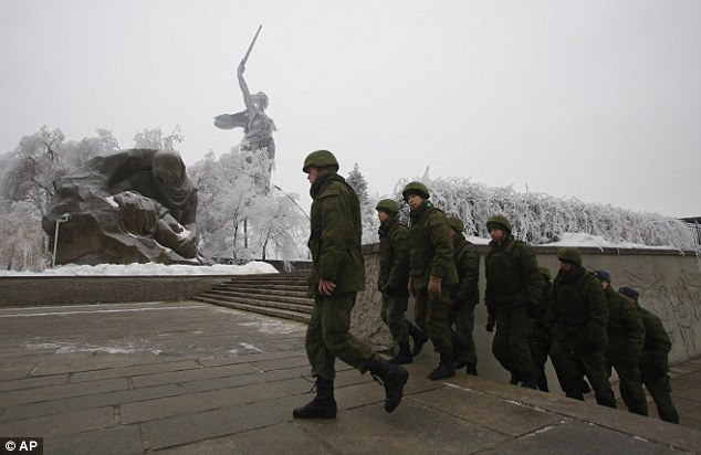 Around 5,200 police and interior troops have been mobilised throughout Volgograd following two deadly bomb blasts in less than 24 hours. Above, soldiers patrol the Battle of Stalingrad memorial in the city today