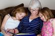 Grandma Reading a Story to her Grandchildren