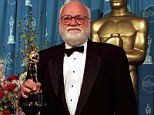 And the winner is: Saul Zaentz poses in 1997 with the Best Picture Oscar for The English Patient