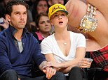 Check out that bling! Kaley Cuoco proudly displays wedding and engagement rings at Lakers game with new husband Ryan Sweeting