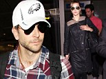 Under wraps! Bradley Cooper and his model girlfriend Suki Waterhouse sport checked shirt and black coat for low key LAX arrival