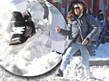 Its not snow' white: Sarah didn't make the best footwear choice as she waded through the snow in trainers in NYC