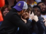 Taking their eyes off the ball! Mila Kunis and Ashton Kutcher pucker up for the Kiss Cam courtside at LA Lakers game