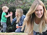 Say cheese! Hilary Duff feeds her little boy cheddar Goldfish crackers during playful romp in the park