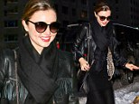 Sheer daring! Miranda Kerr takes mincing steps through snowy New York in see-through dress to get pampered at the salon