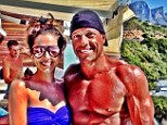 Ripped: Cheryl Cole poses with a mystery hunk during her current stay in Cape Town, South Africa