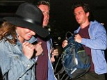 Lea Michele flies home in wide-brimmed hat and denim jacket with former Glee costar Jonathan Groff after 'amazing' New Year's break