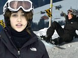 Madonna's daughter Lourdes laughs off a fall while snowboarding in the Swiss Alps during family holiday
