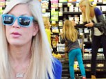 Tori Spelling looks frazzled during grocery run with kids as it's revealed there 'is NO prenup with cheating husband Dean McDermott'