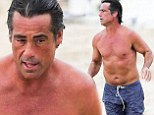 Comedy actor Peter Dante, 45, shows off his impressive physique as he runs on the beach shirtless in Hawaii